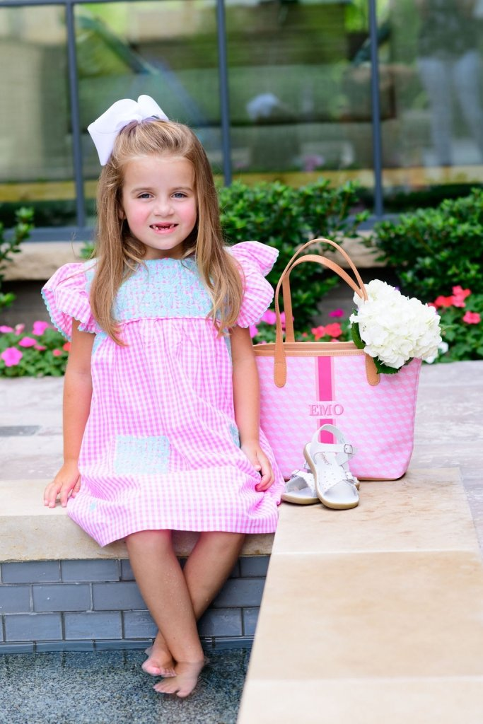 girl in a J. Marie dress and barrington tote bag