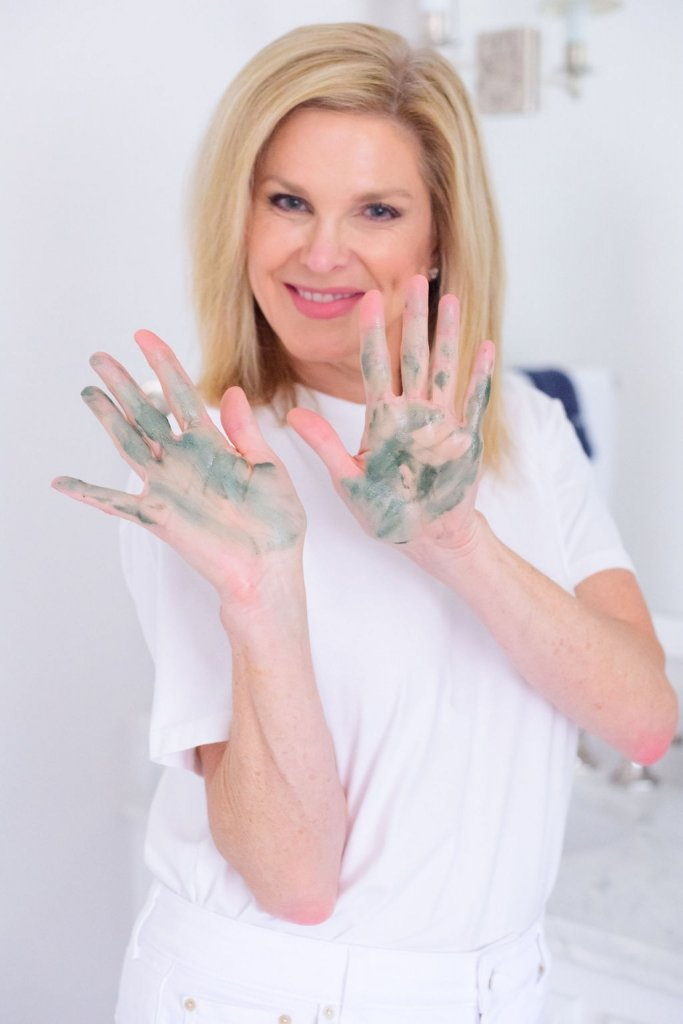Tanya Foster with moor mud mask on her hands