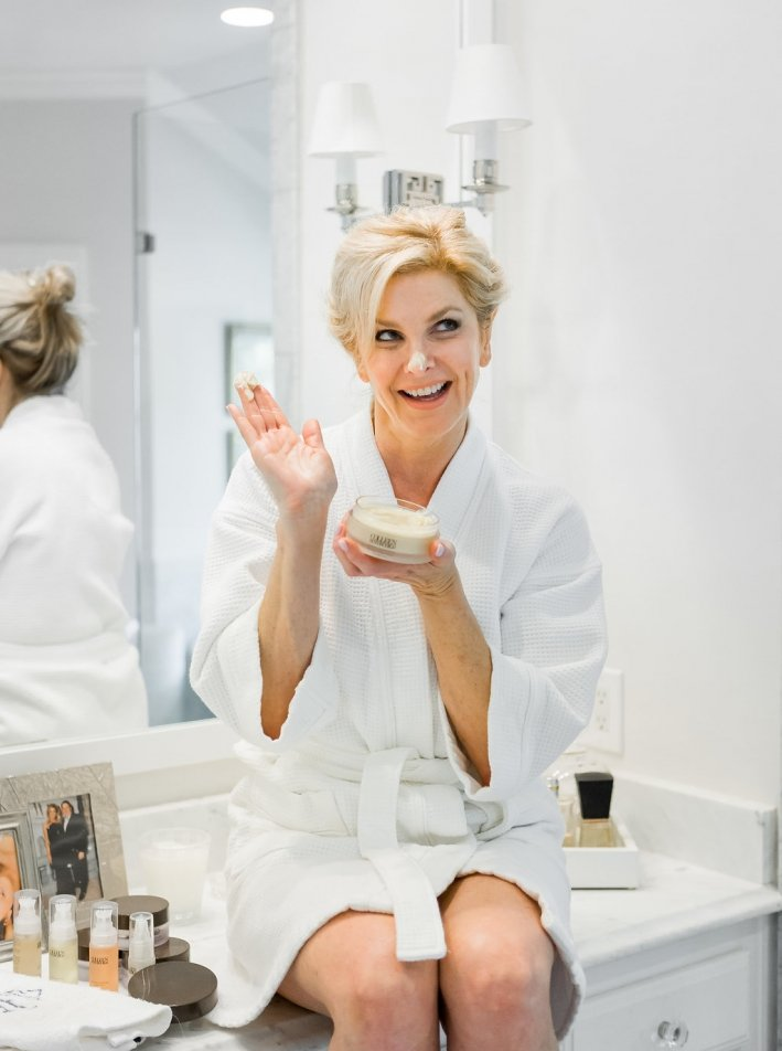 Colleen Rothschild's best sellers - 25% off!   Colleen Rothschild's Sale! by popular Dallas beauty blogger, Tanya Foster: image of a woman applying Colleen Rothschild facial cream.