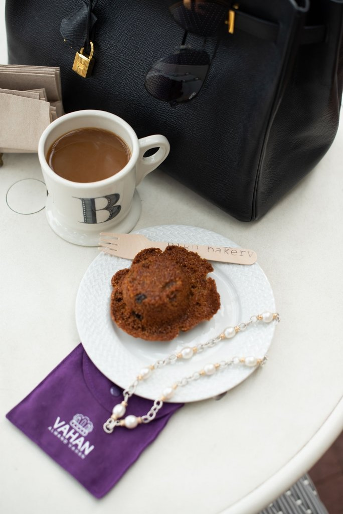 cup of coffee with a muffin bird bakery